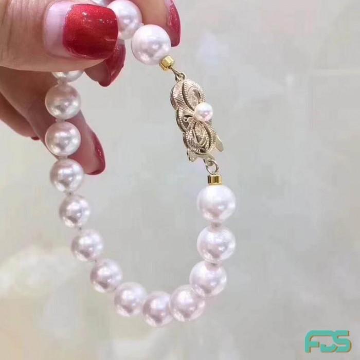 Bracelet  Perles d'Eau Douce presque rondes & Fermoir Argent